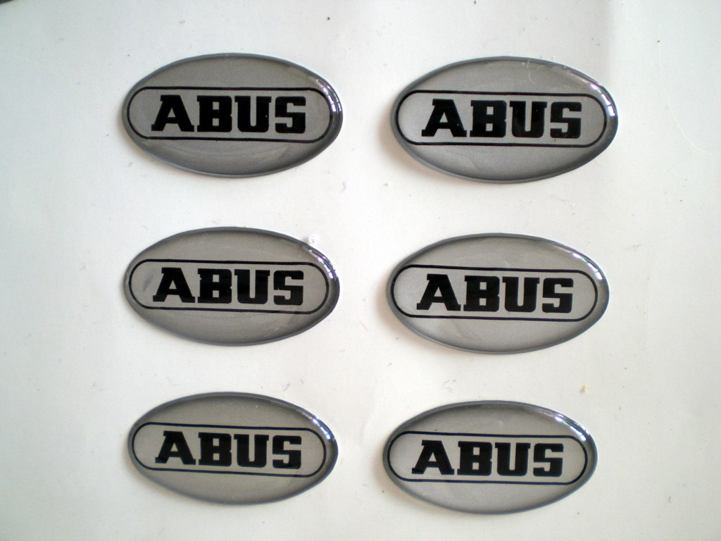Black Print ABUS Elevator Epoxy Resin Stickers Made By Normal Silver Background